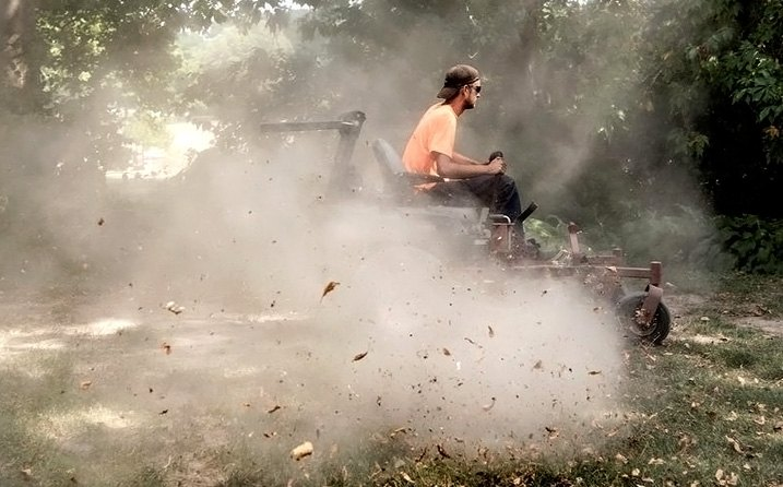 Riding Mower In Dust Cloud
