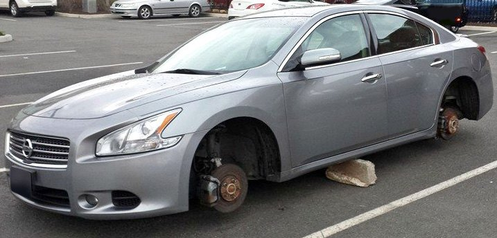 Nissan With Wheels Stolen