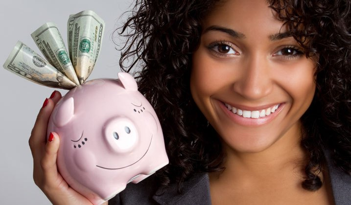 Girl With Piggy Bank Full Of Saved Money