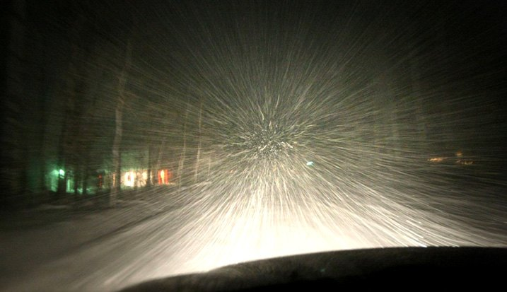 Driving Through Snow Storm In Wintry Climate