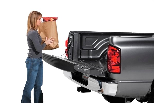 may not reflect your exact vehicle! Dee Zee® - Tailgate Assist in Use