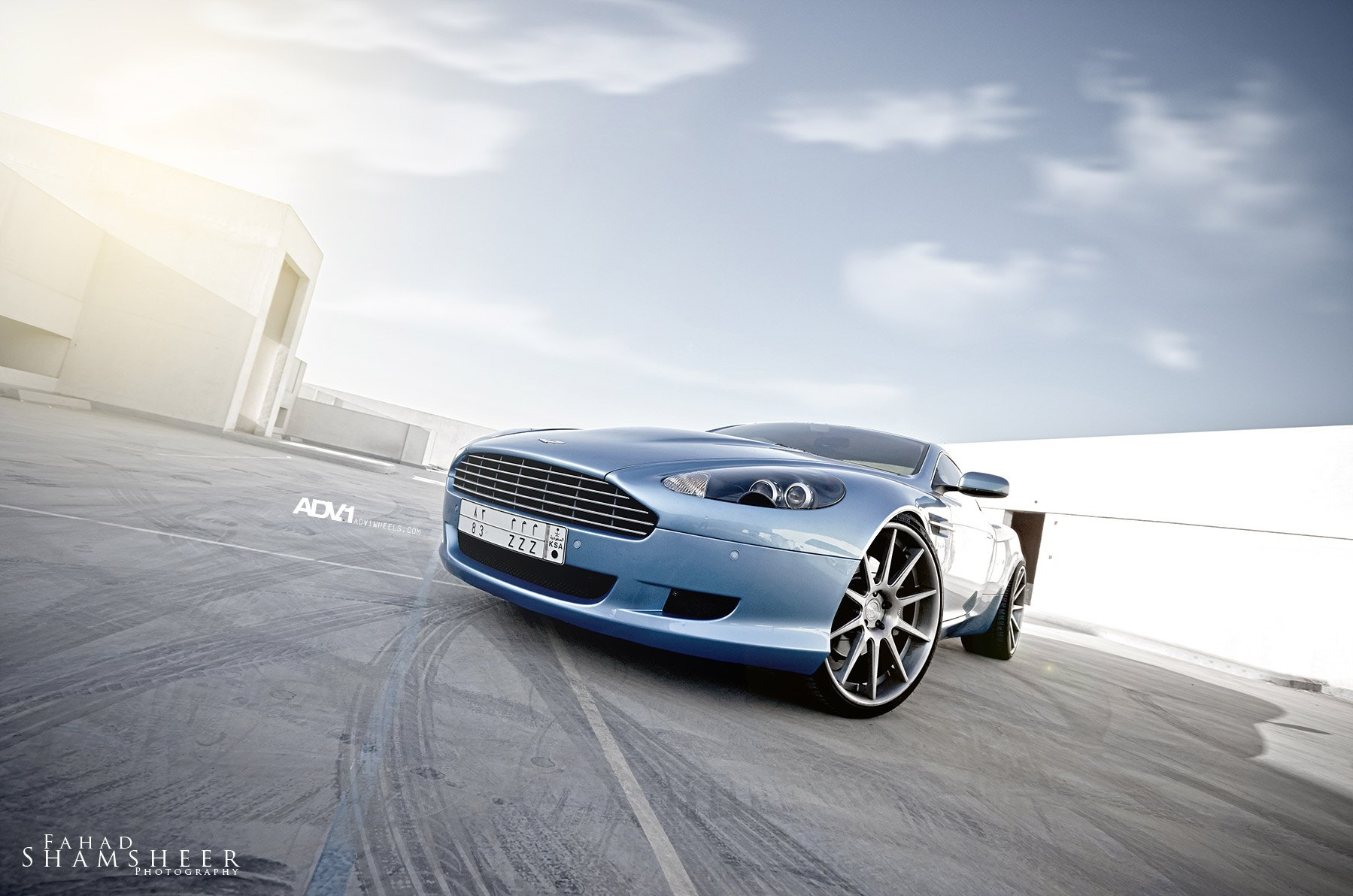 What classy looks like aston martin db9 fitted with adv1 rims light blue aston martin db9 with custom headlights photo by adv1 sciox Images