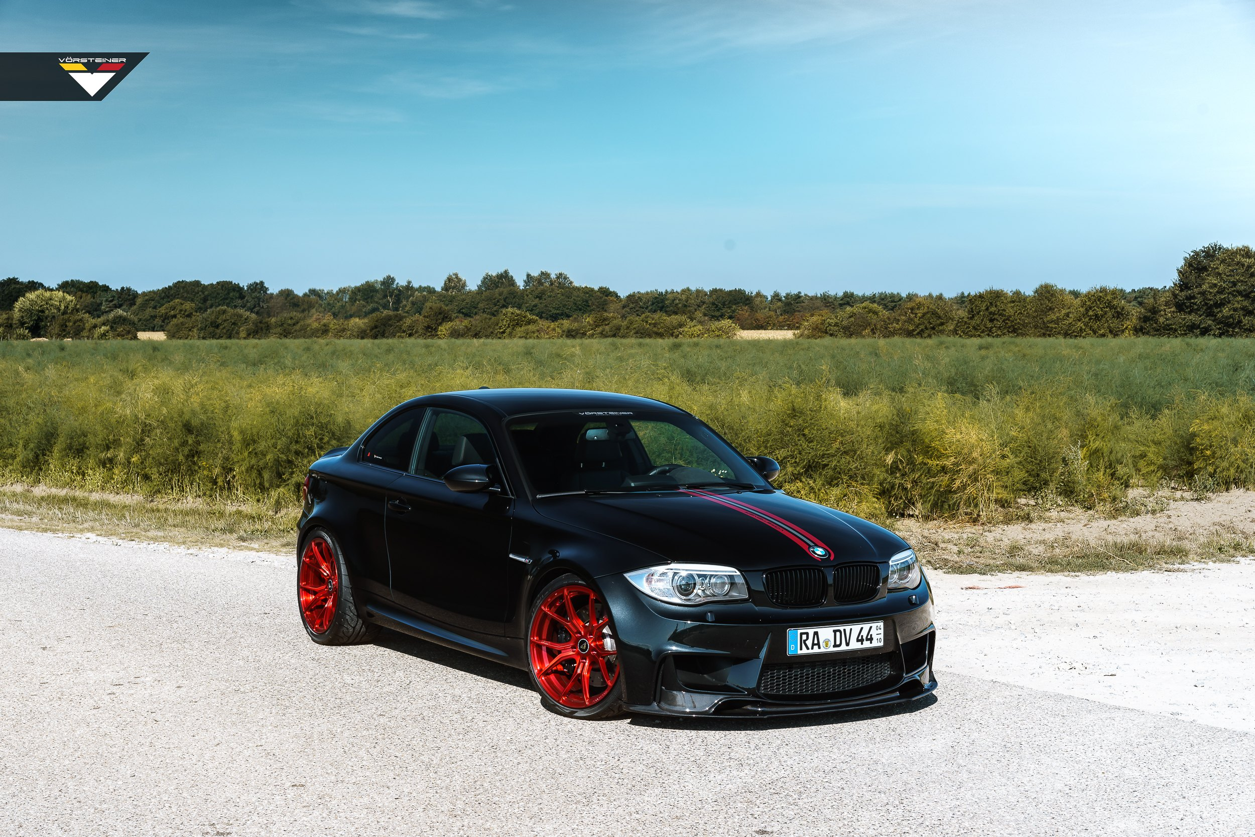 Custom Black Matte Bmw 1 Series Grabs Attention With Red Custom Wheels Carid Com Gallery