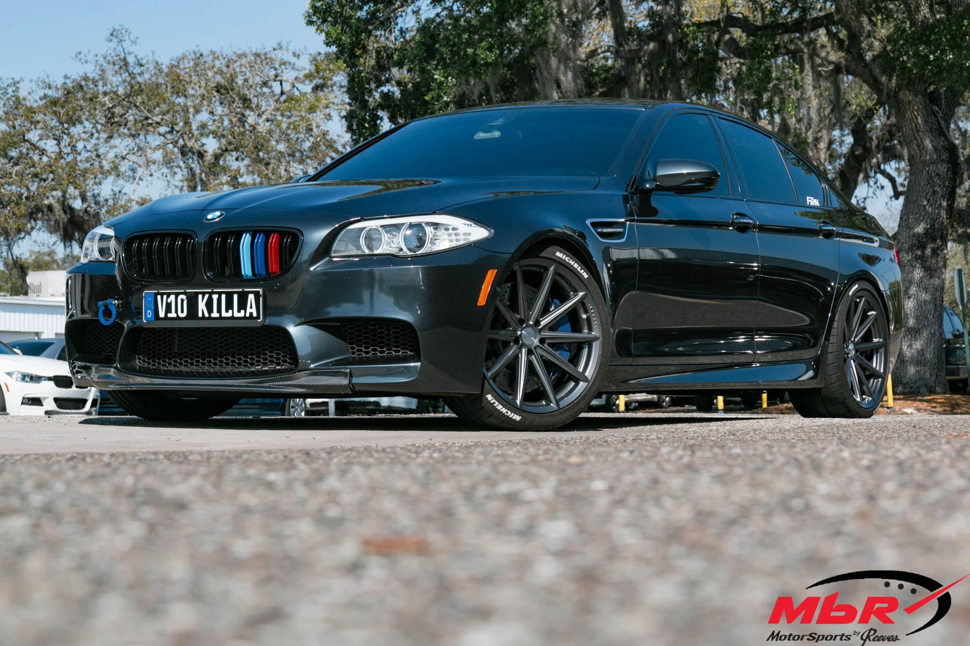 Carbon fiber lip and vossen rims on black bmw m5 carid gallery black bmw 5 series with carbon fiber front lip photo by vossen sciox Images