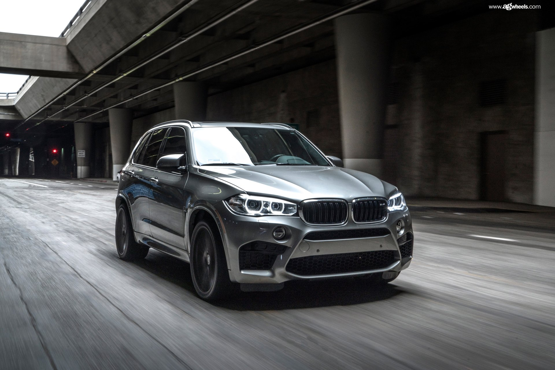 Silver BMW X5 With Custom Halo Headlights