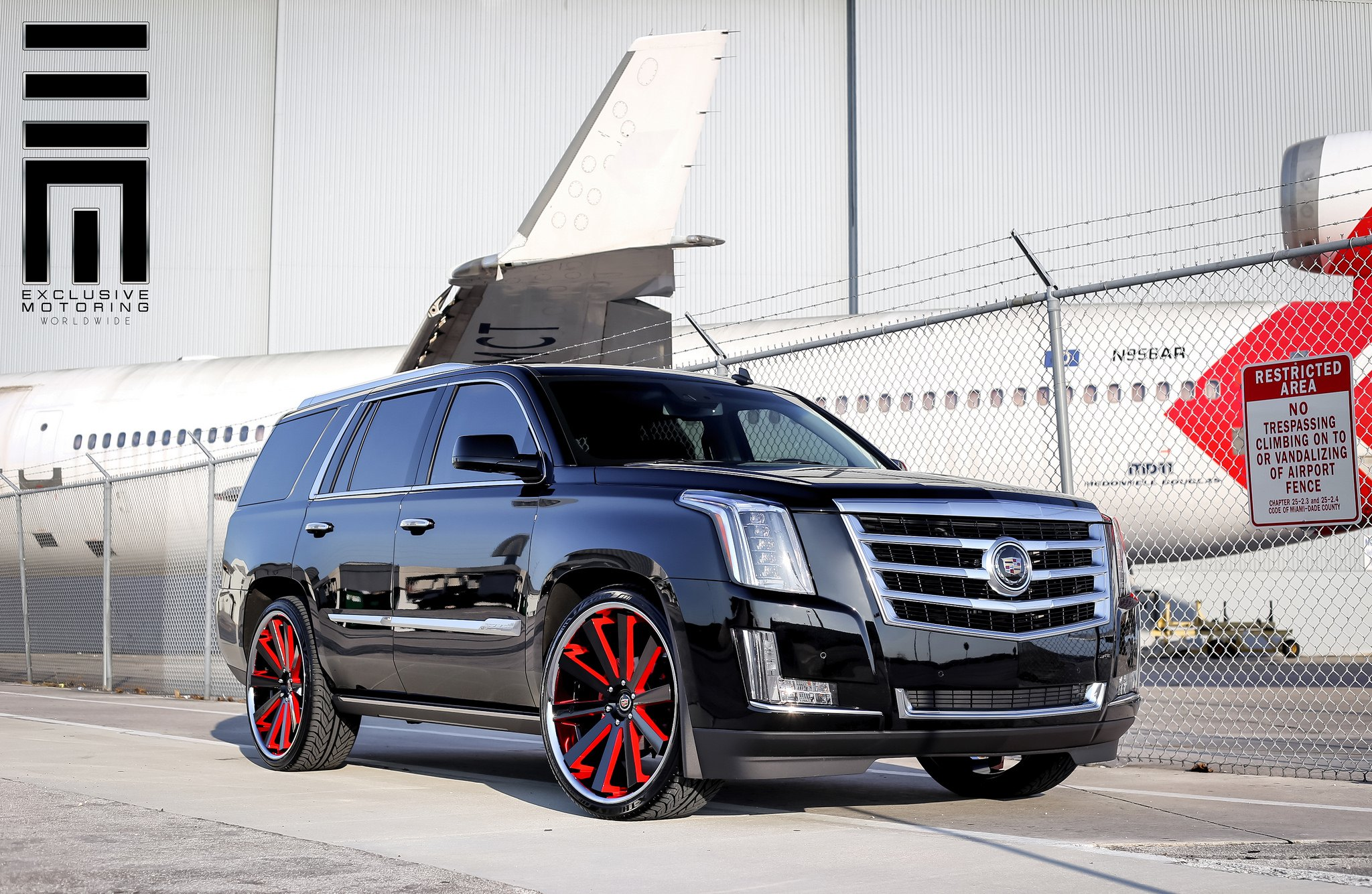 2015 Cadillac Escalade Custom >> Cadillac Escalade on Custom Rims With Red Accents — CARiD.com Gallery