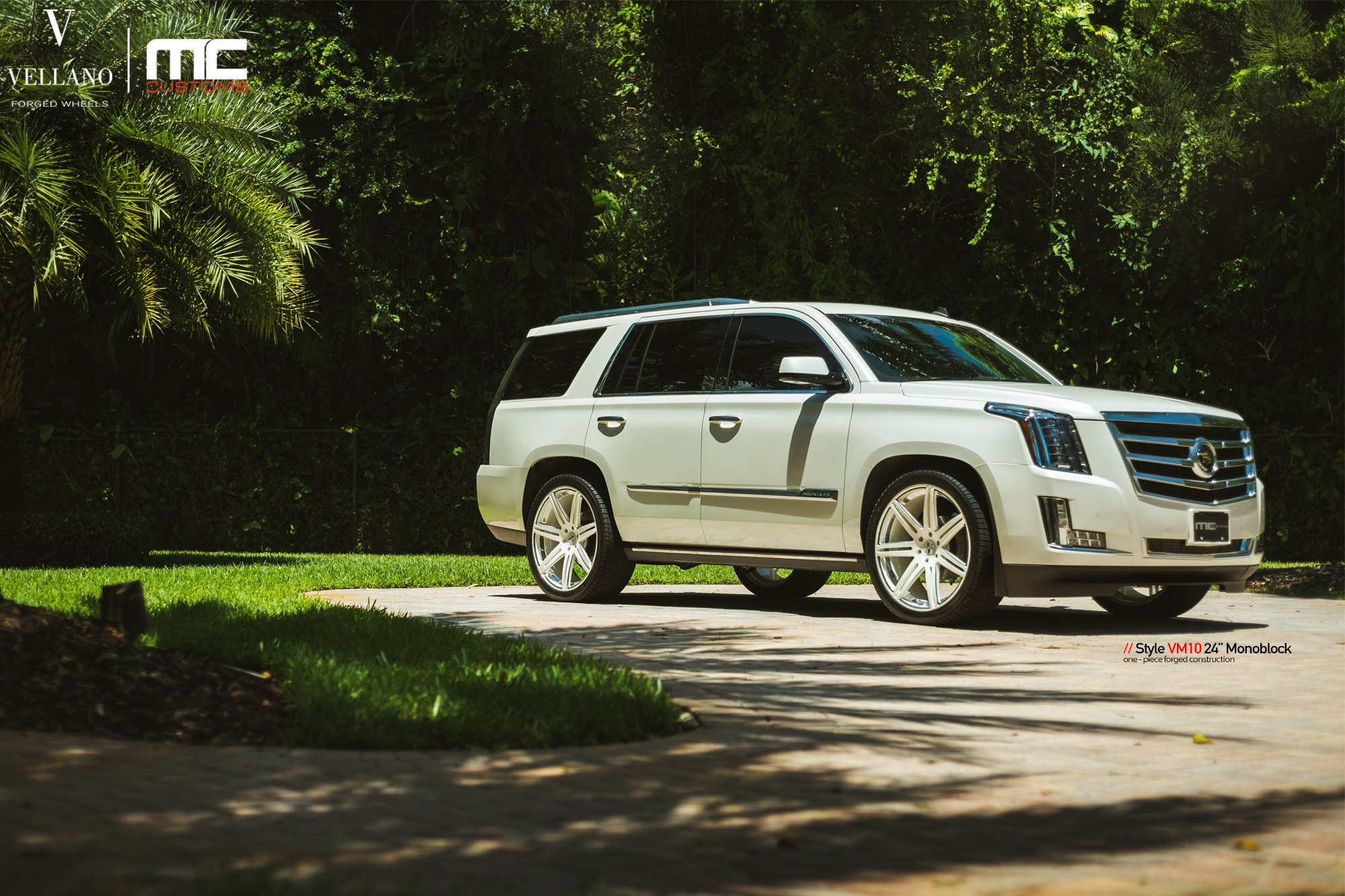 White Cadillac Escalade Enhanced By Chrome Details And Jaw