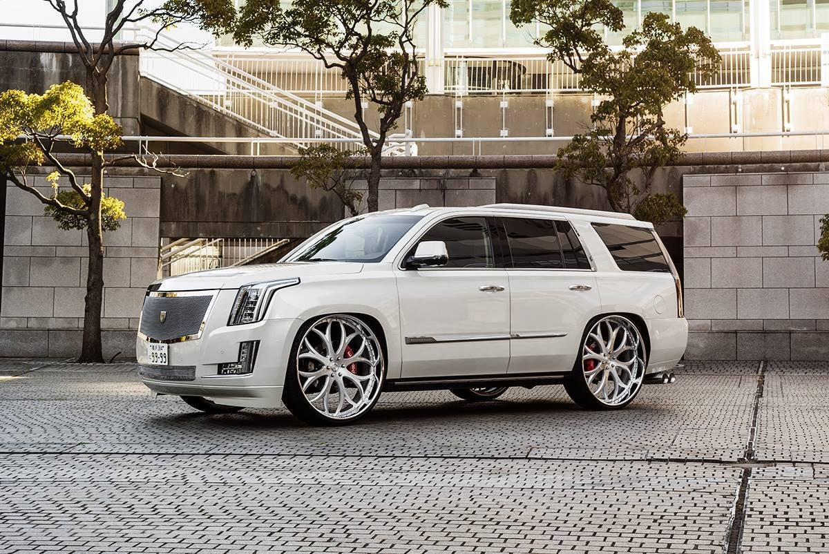 sophisticated white cadillac escalade put on chrome lexani wheels gallery. Black Bedroom Furniture Sets. Home Design Ideas