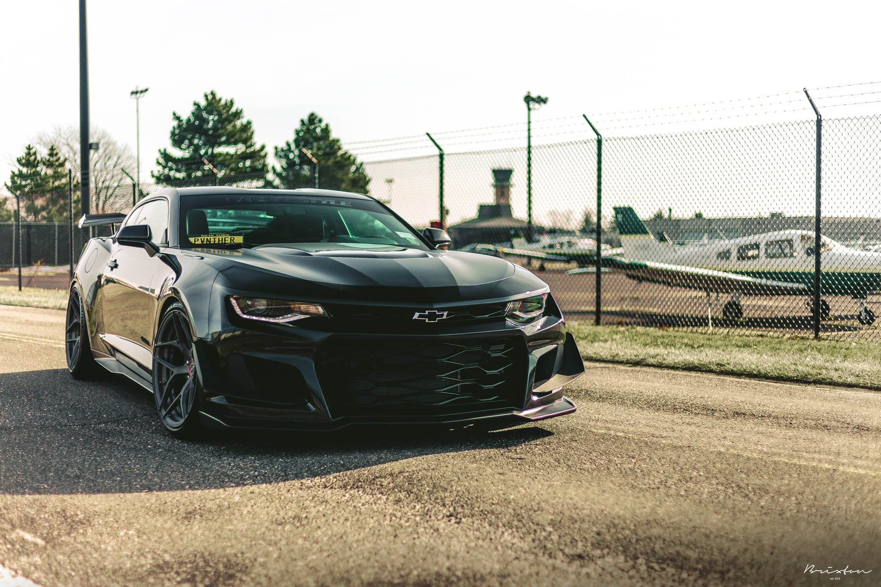Black Chevy Camaro with Custom Front Lip - Photo by Brixton Forged Wheels
