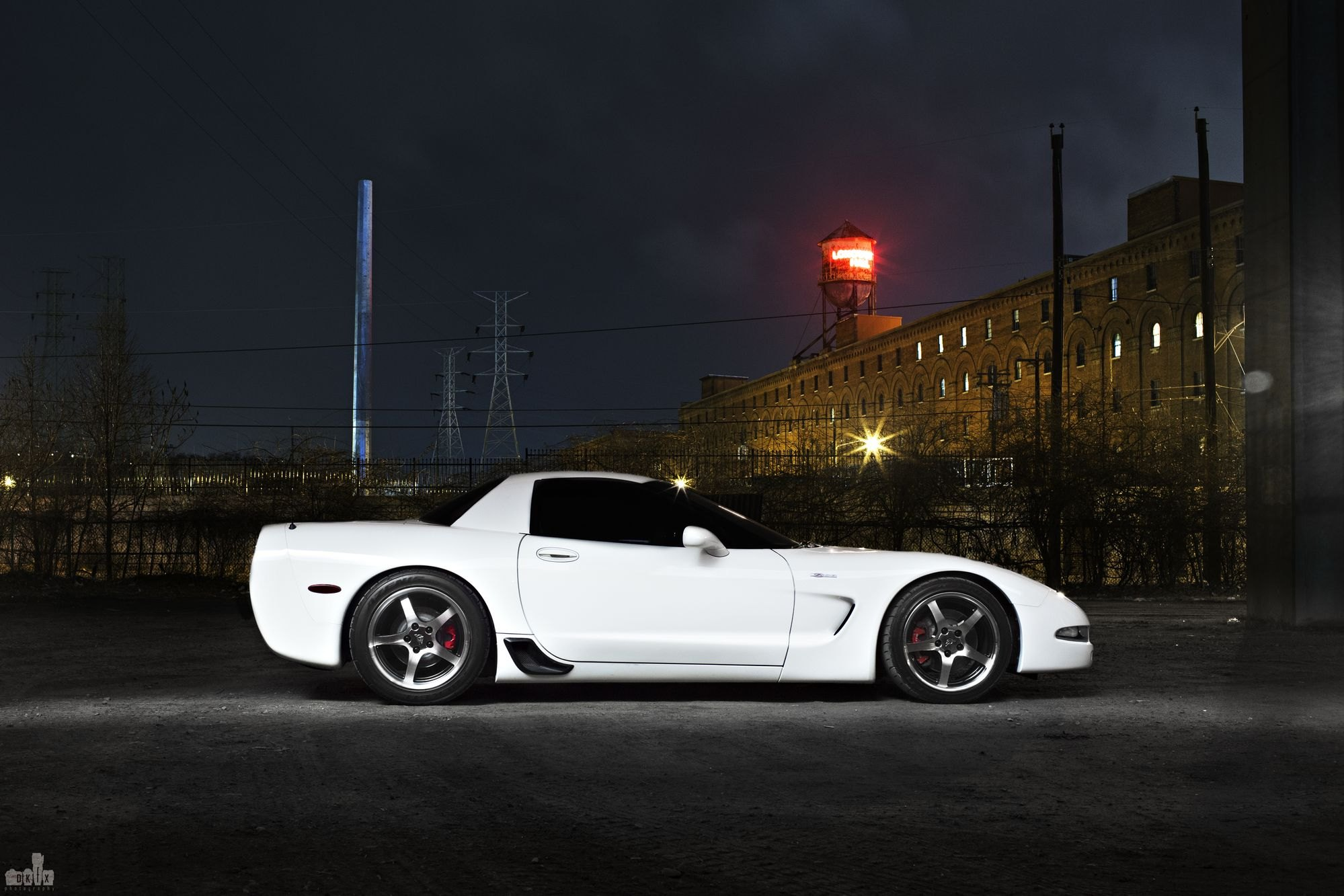 Aftermarket Side Scoops on White Chevy Corvette - Photo by dan kinzie