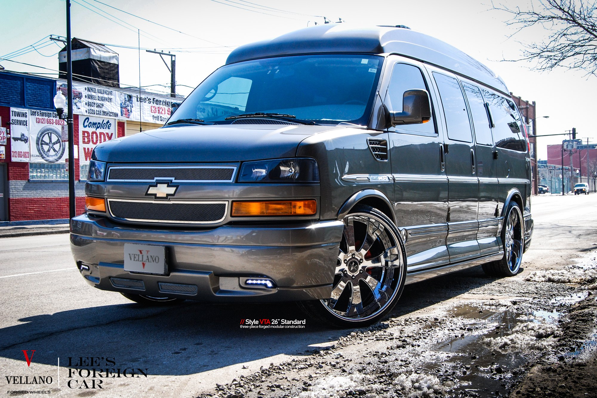 Gray Chevy Express With Chrome Mesh Grille