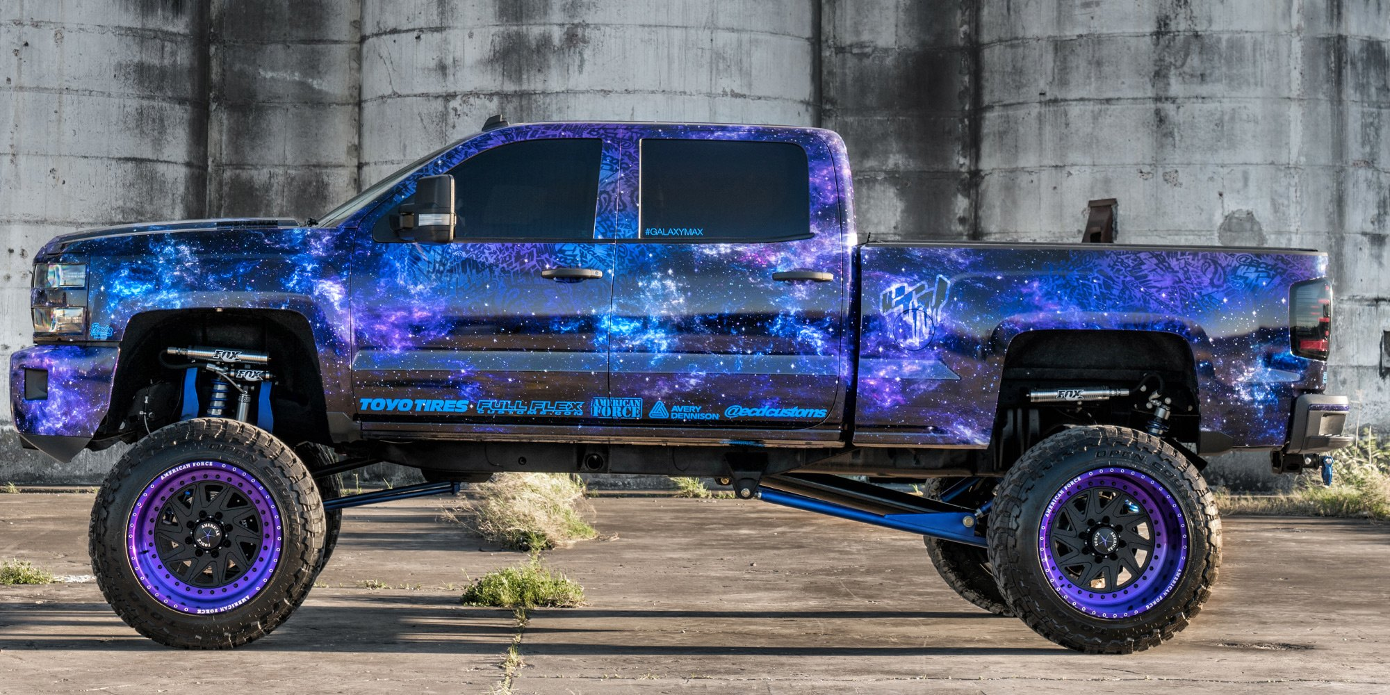 Black American Force Rims With Purple Lips on Lifted Silverado - Photo by Dale Martin