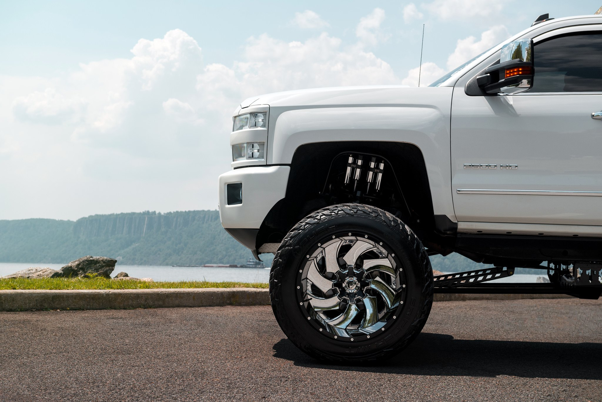 White Chevy Silverado On Fuel Offroad Wheels Gets A Great Lift Kit Lifted Gripper Tires Photo By Off Road