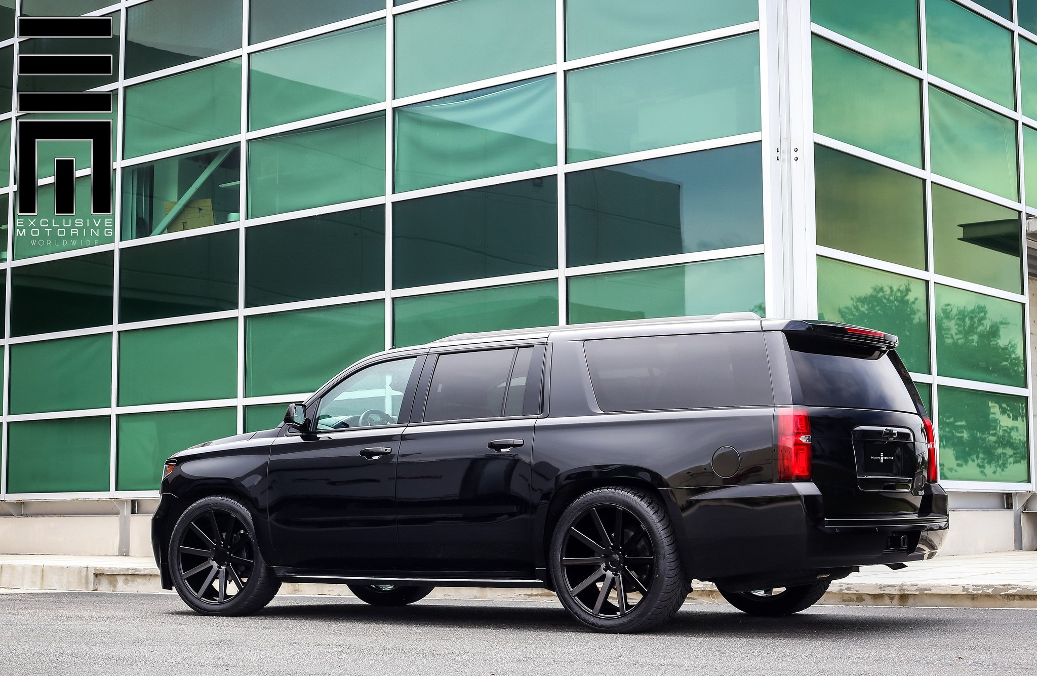 all black chevy suburban on custom wheels by exclusive motoring gallery. Black Bedroom Furniture Sets. Home Design Ideas