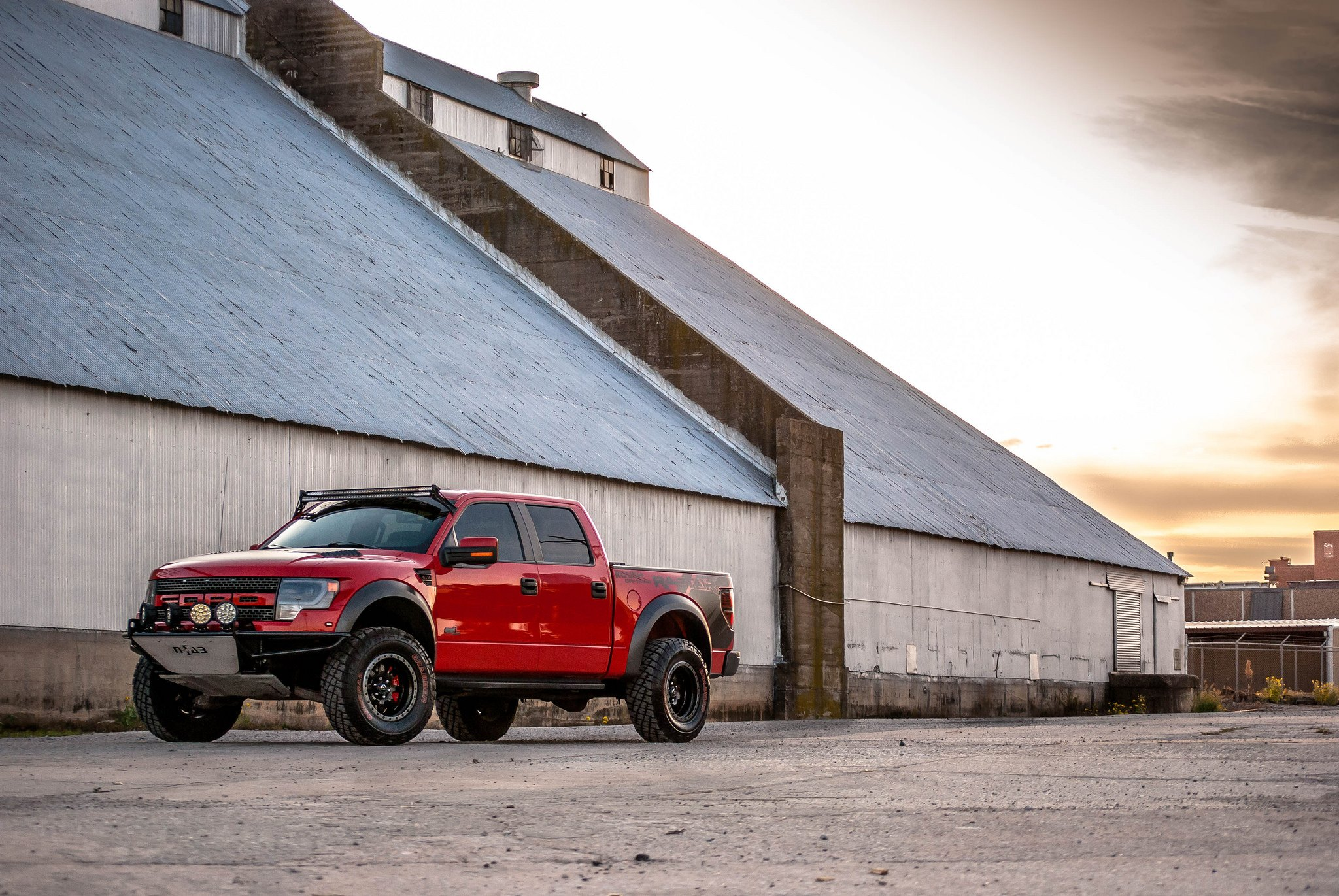 Custom Black Fuel Offroad Wheels on Red Ford F-150 - Photo by Fuel Offroad