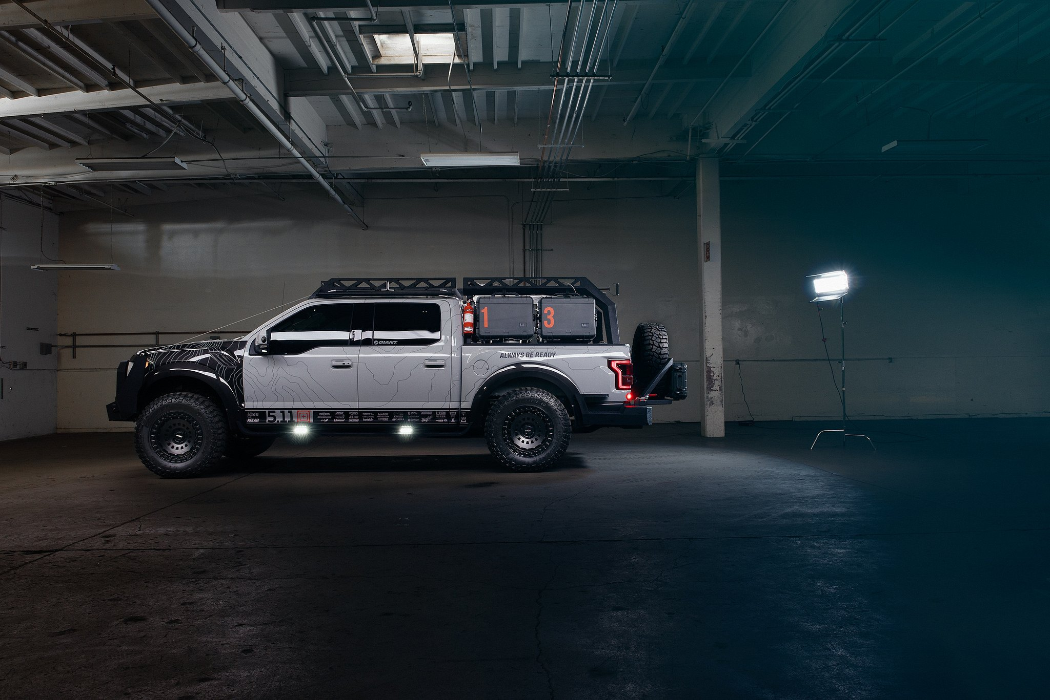 Gray Lifted Ford Raptor with Matte Black Rotiform Rims - Photo by Rotiform