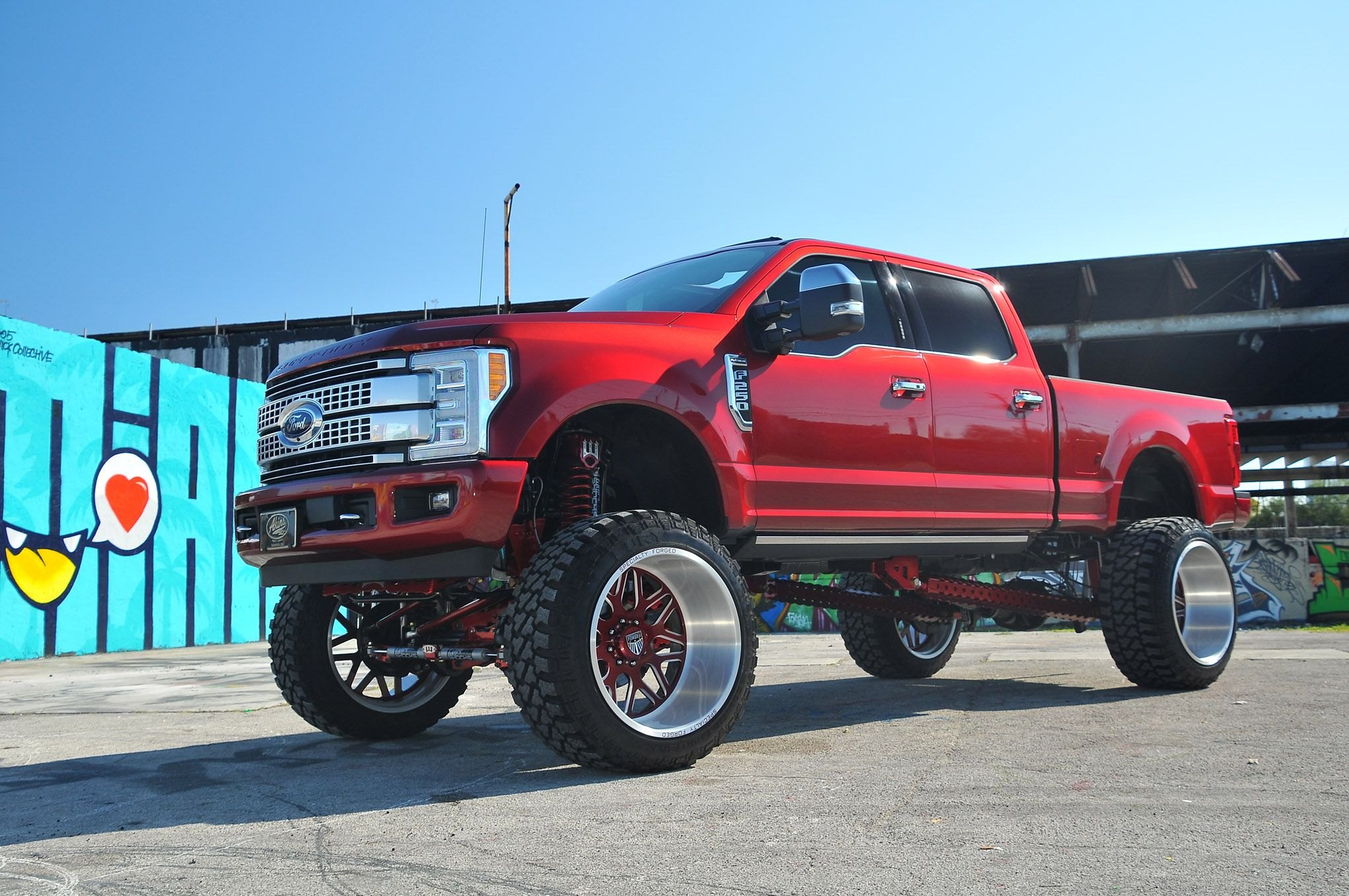 Red lifted ford f 250 with aftermarket headlights photo by phil gordon