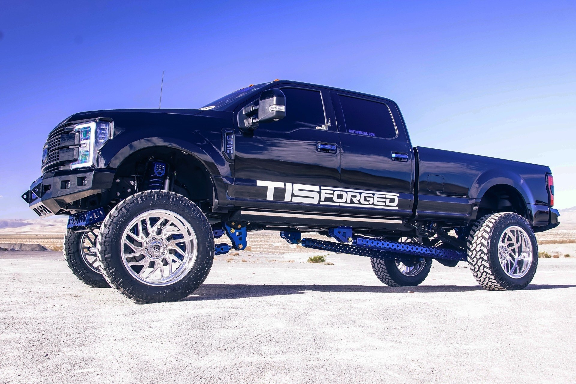 Black Lifted Ford F-350 with Aftermarket Running Boards - Photo by TIS Wheels