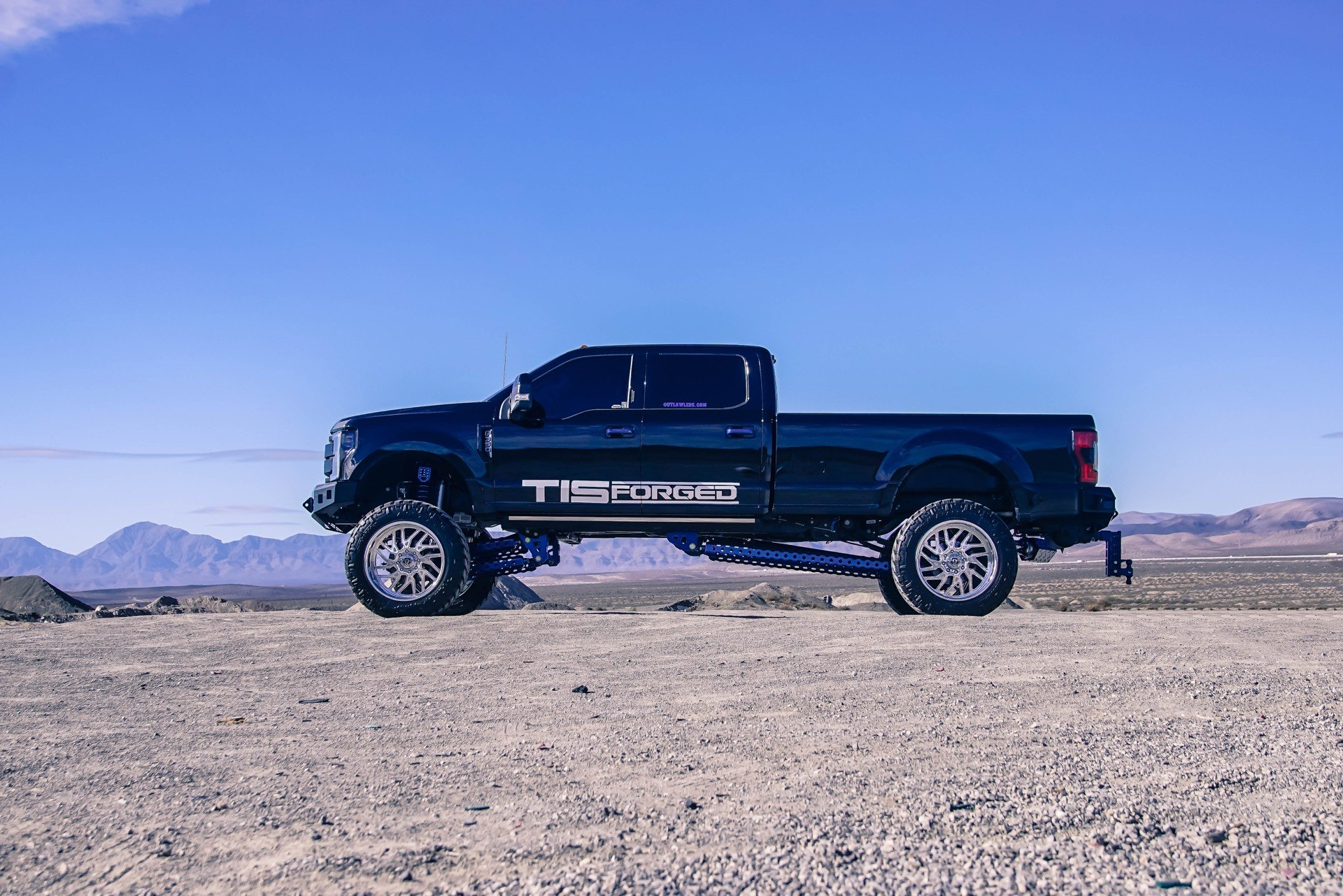 Custom Lift Kit on Black Lifted Ford F-350 - Photo by TIS Wheels