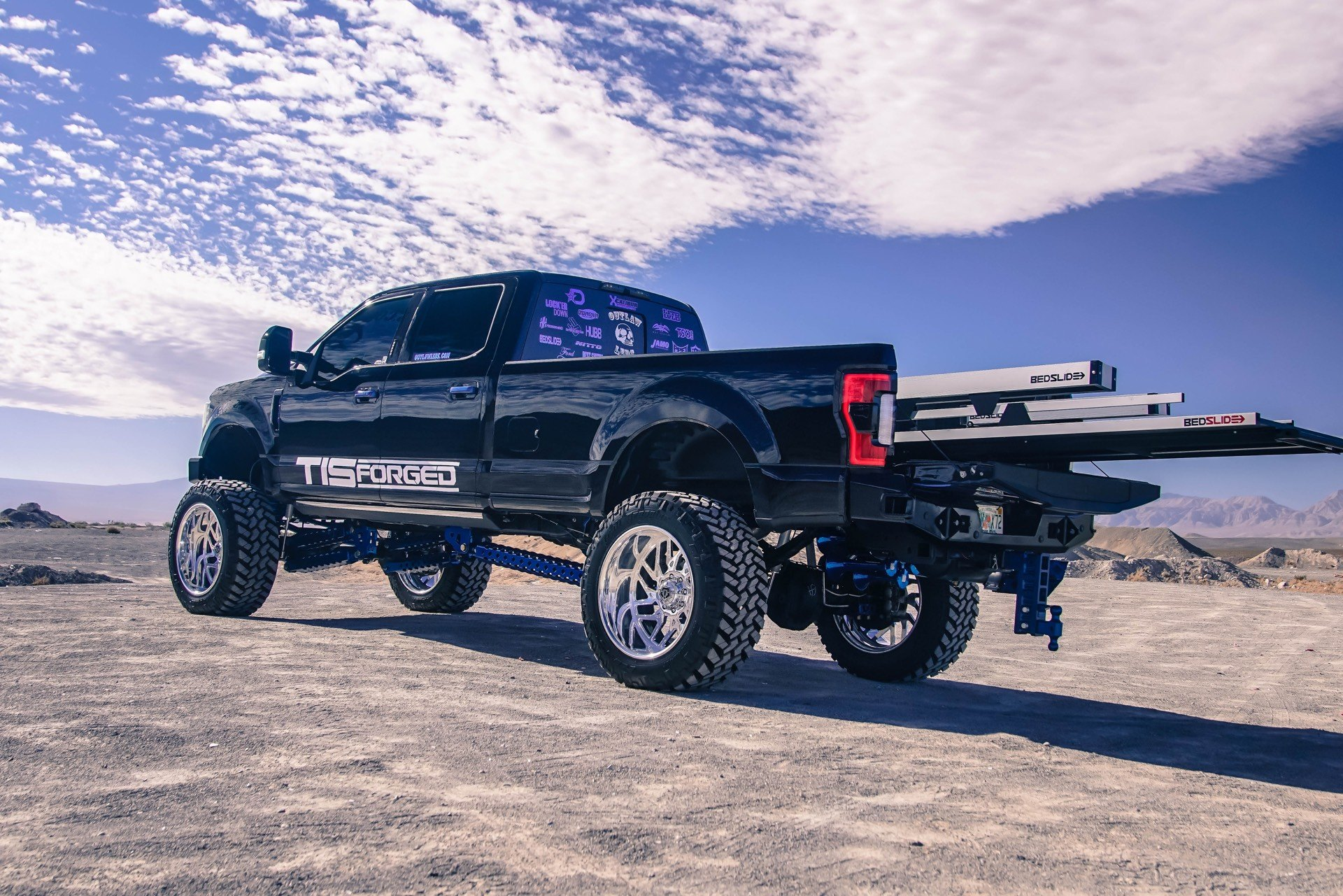 Black Lifted Ford F-350 with BedSlide Cargo Slide - Photo by TIS Wheels