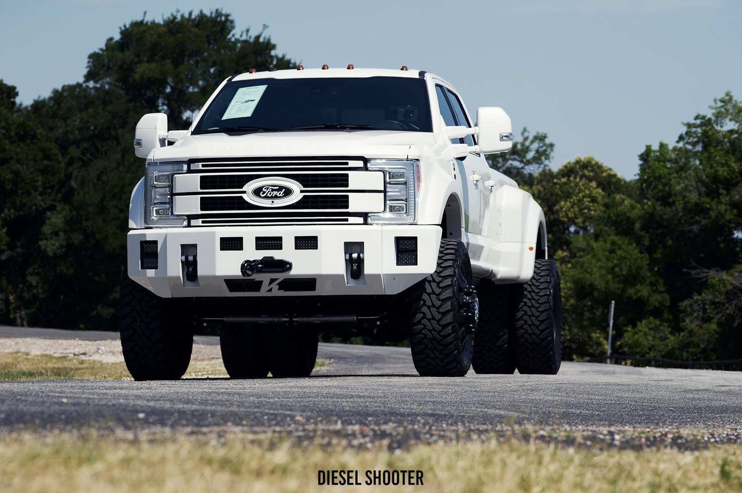 White lifted ford f 450 on toyo open country m t tires photo
