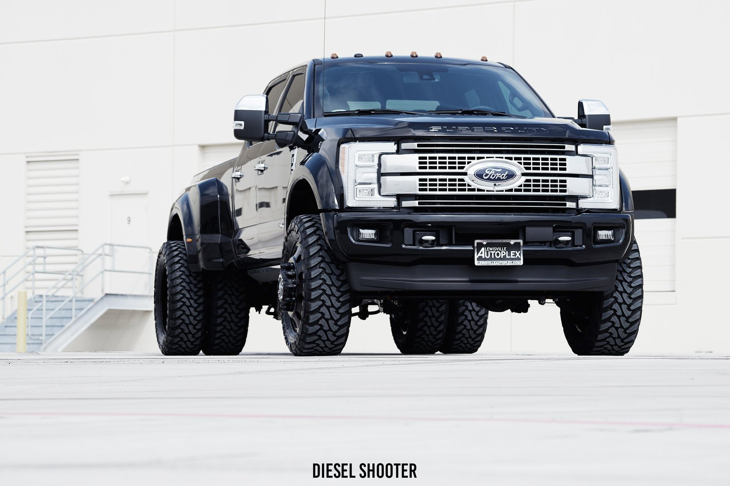 Black ford f 450 on custom american force wheels photo by diesel shooter