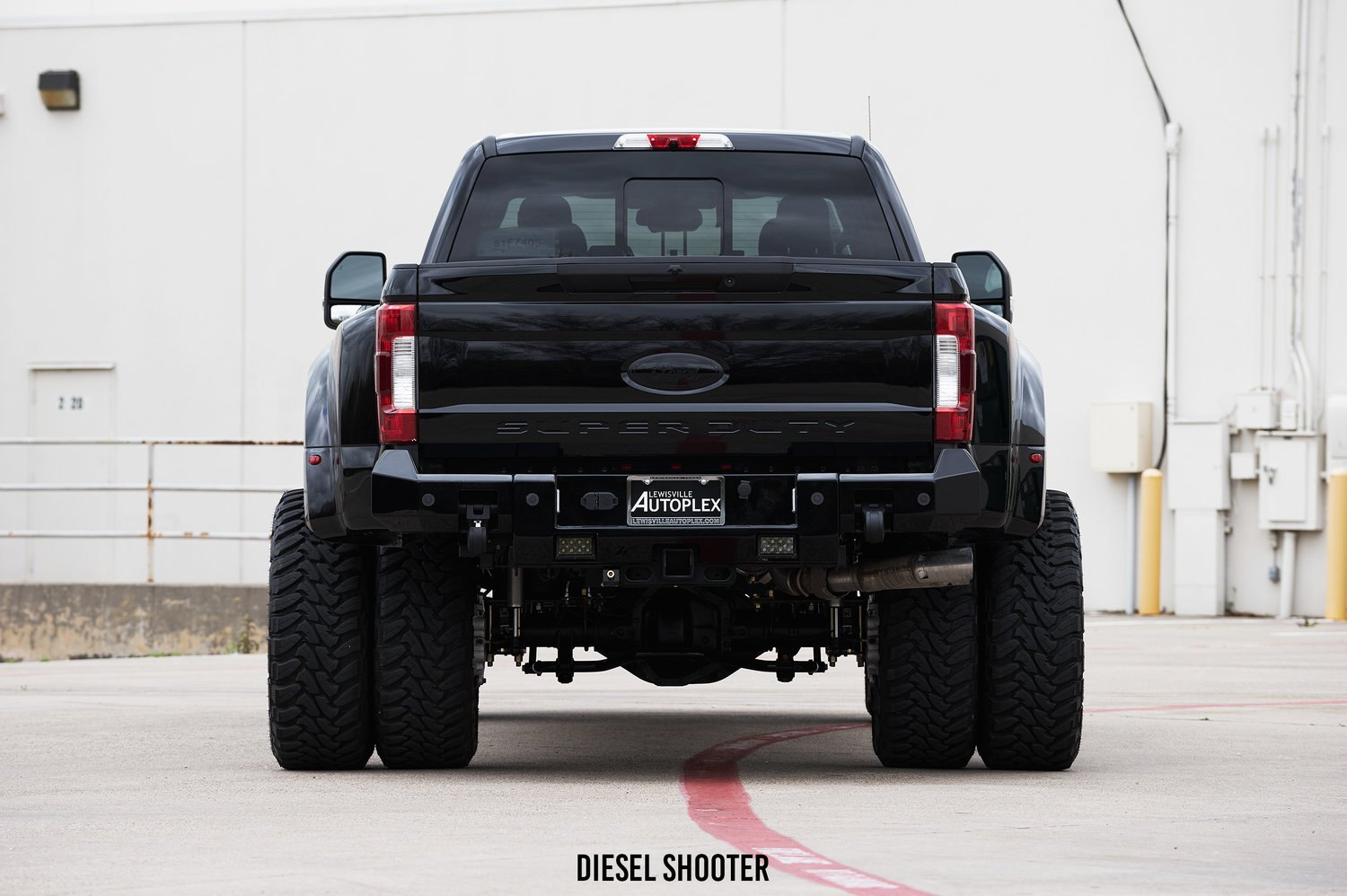 6 Inch Suspension Lift Kit on Custom Black Ford F-450 - Photo by Diesel Shooter