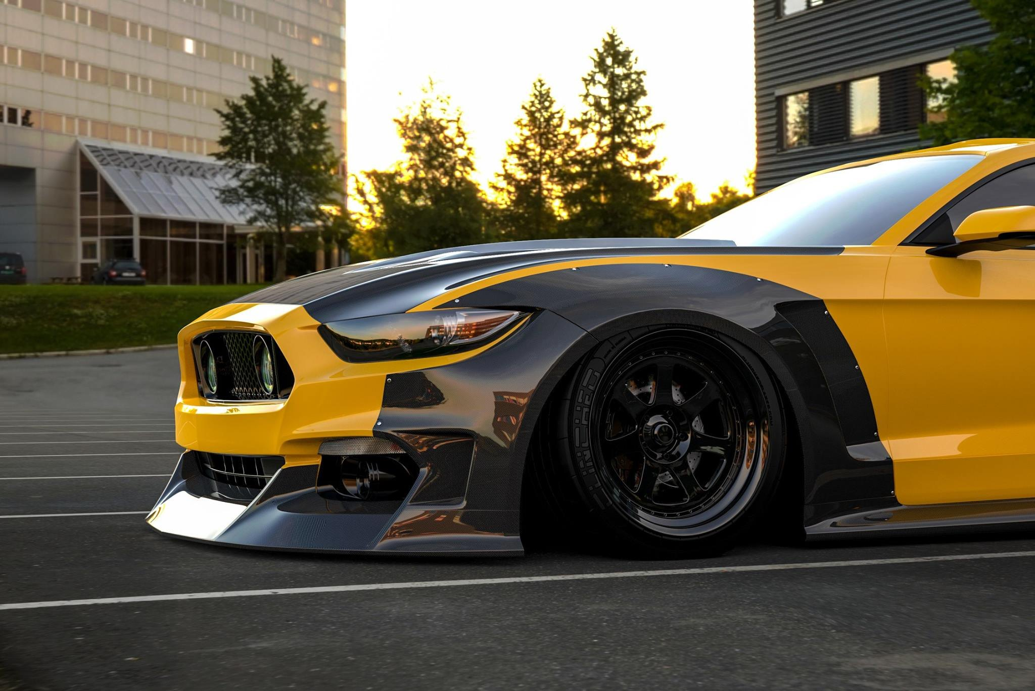 Carbon Fiber Front Bumper on Yellow Ford Mustang - Photo by Clinched