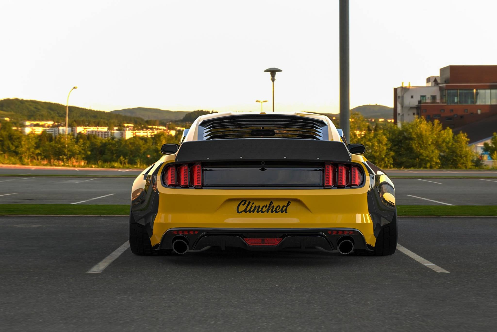 Yellow Ford Mustang with Aftermarket Rear Diffuser - Photo by Clinched