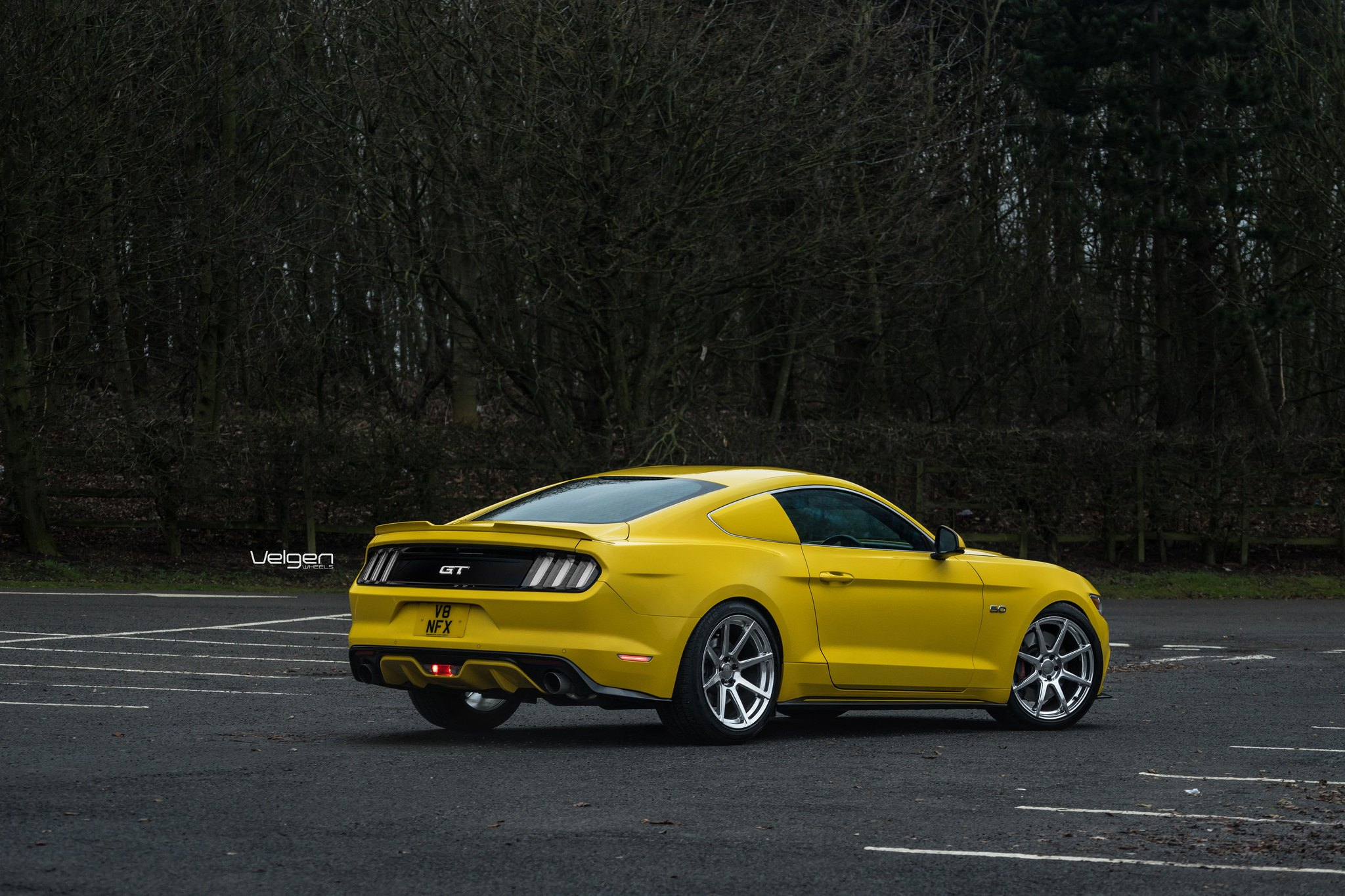 Yellow ford mustang gt with aftermarket rear spoiler photo by velgen