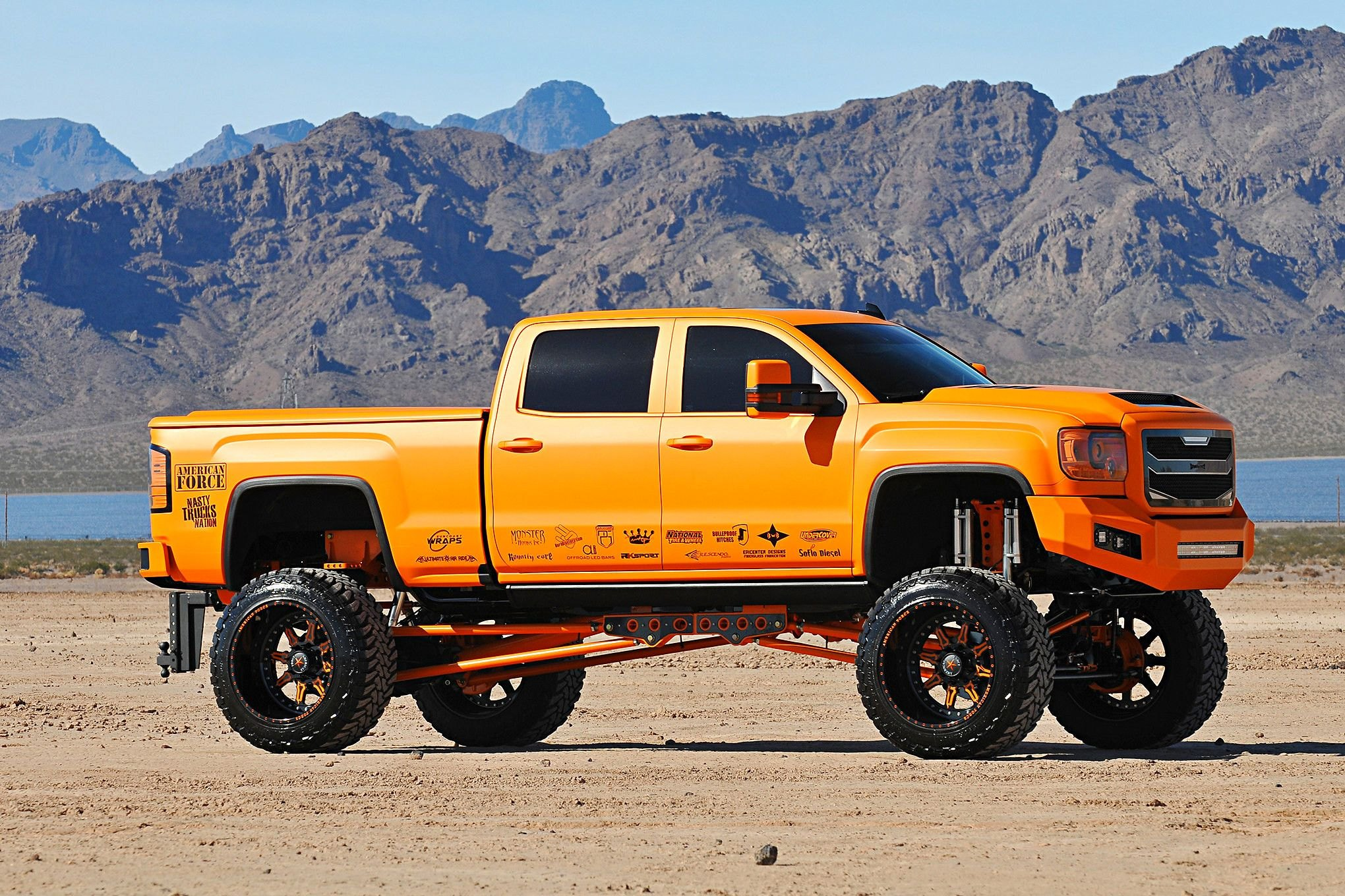 Sunny Orange GMC Sierra on American Force Wheels — CARiD Gallery