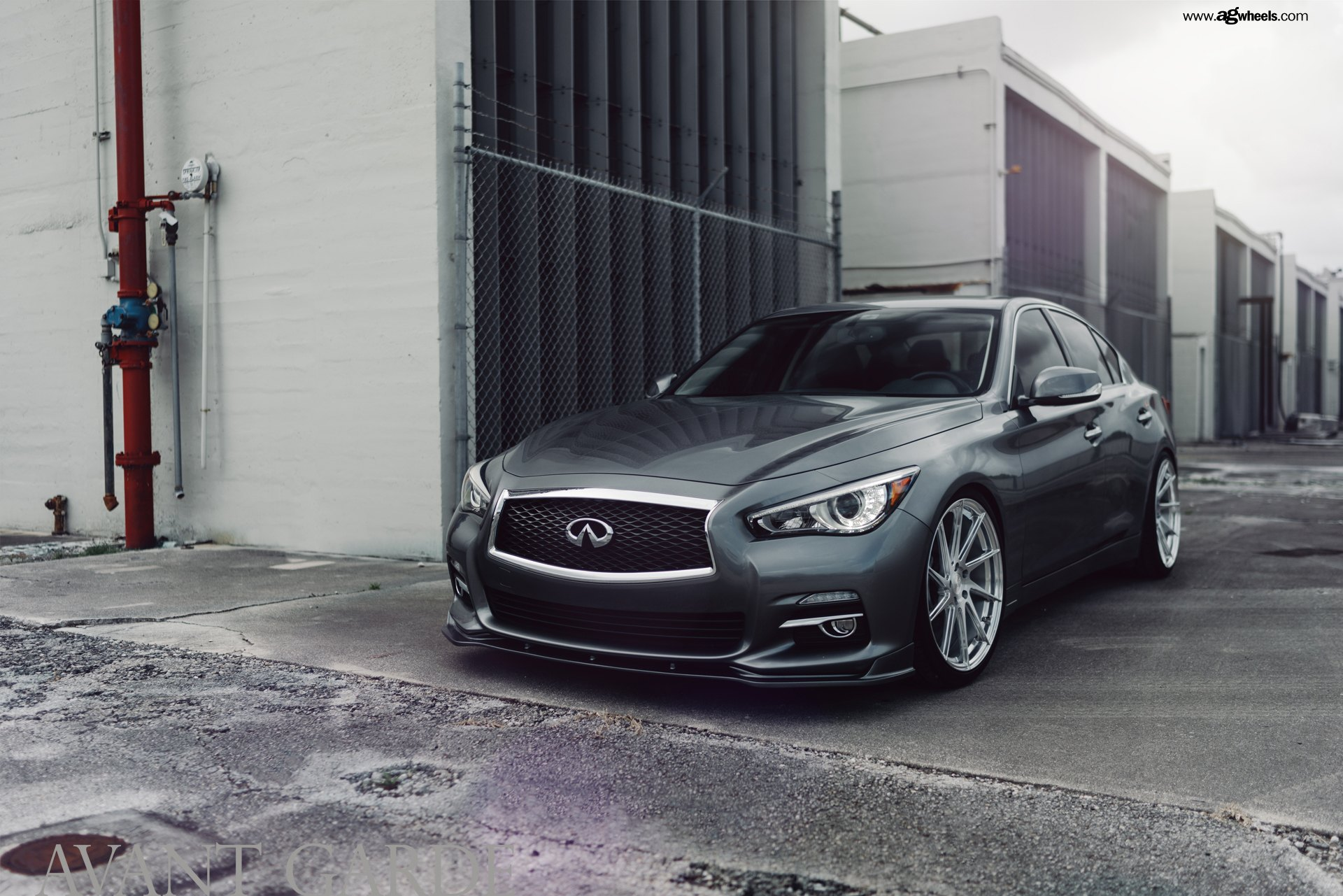 Gray Infiniti Q50 Wearing Custom Avant Garde Rims Wrapped in Hankook