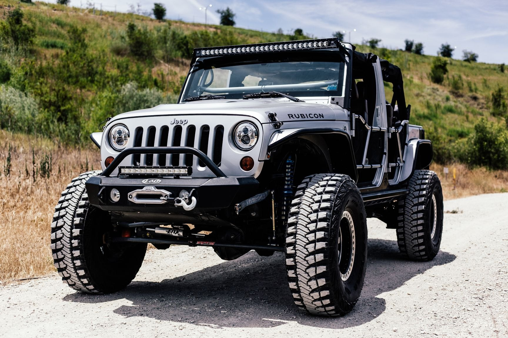 silver bullet: lifted jeep wrangler on fox suspension shocks — carid