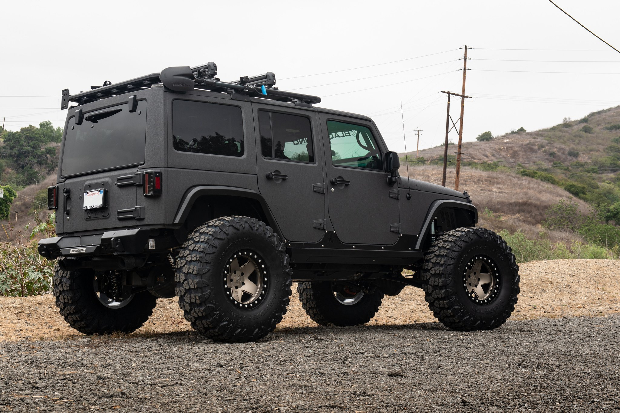 Completely Blacked Out Jeep Wrangler Shod In Off Road Yokohama Tires
