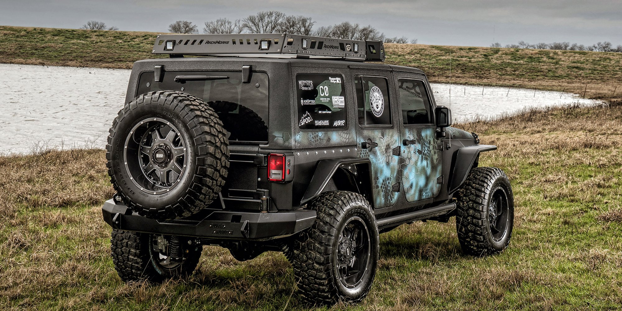 "jk unlimited with custom paint job on 37"" offroad wheels — carid"