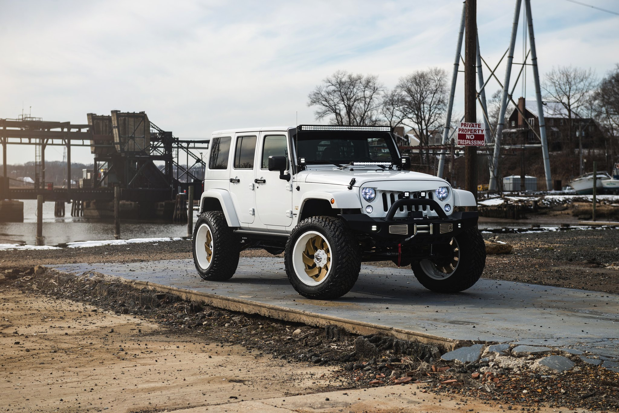 Lifted Jeep Wrangler JK Rolling on Gold Fuel Rims With Colormatched