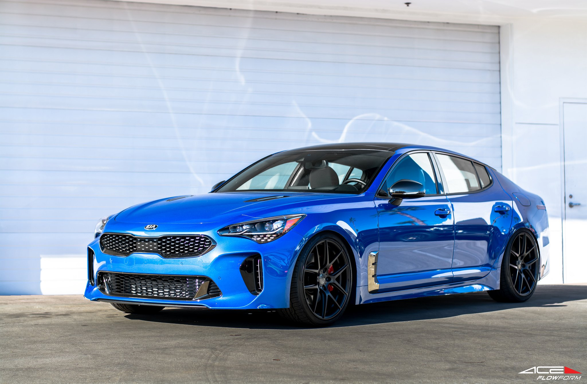 Redesigned Face of Blue Kia Stinger with Custom Mesh Grille — CARiD