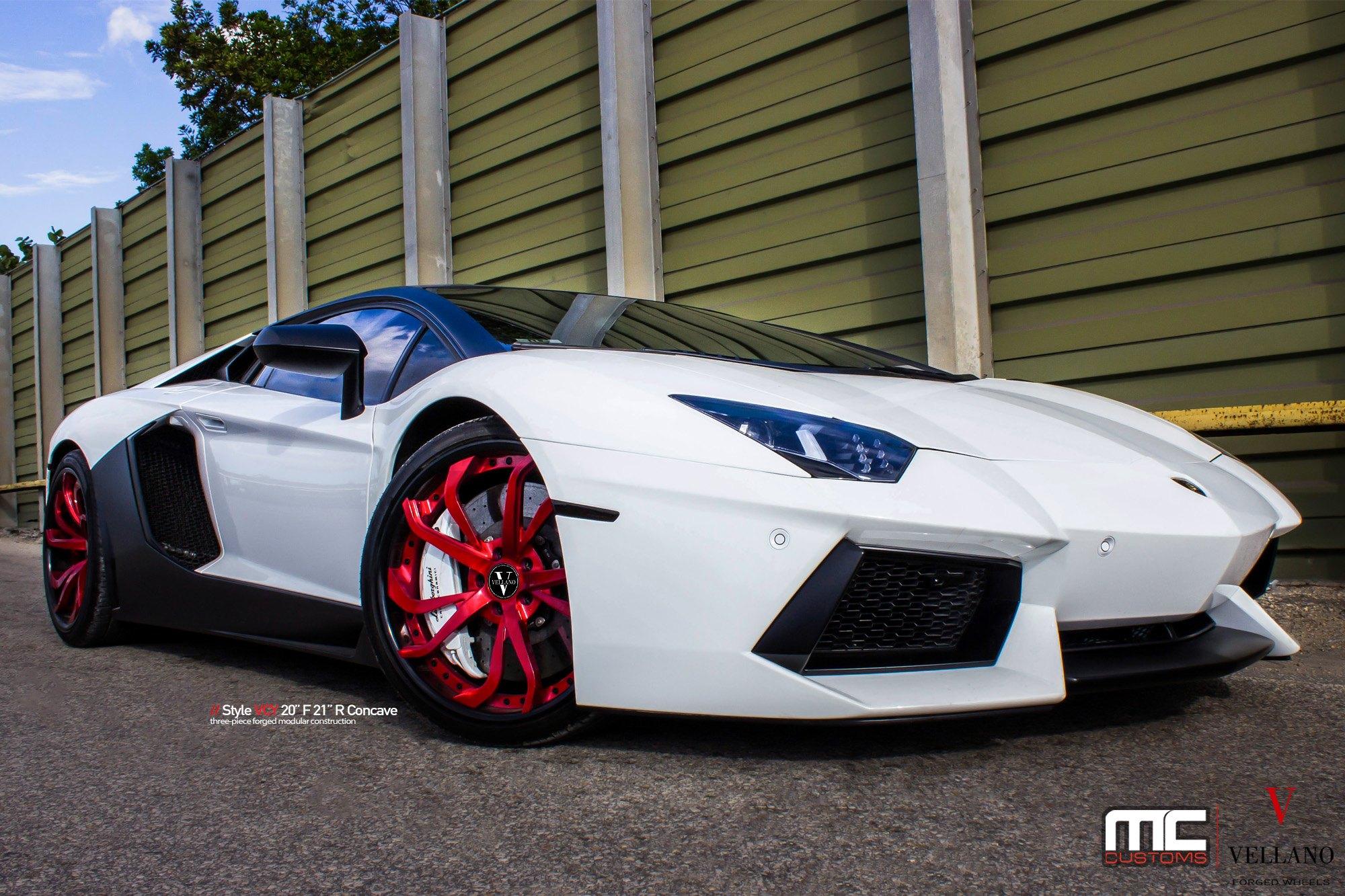 Automotive Stunner White Lambo Boasting Red Concave Vellano Wheels