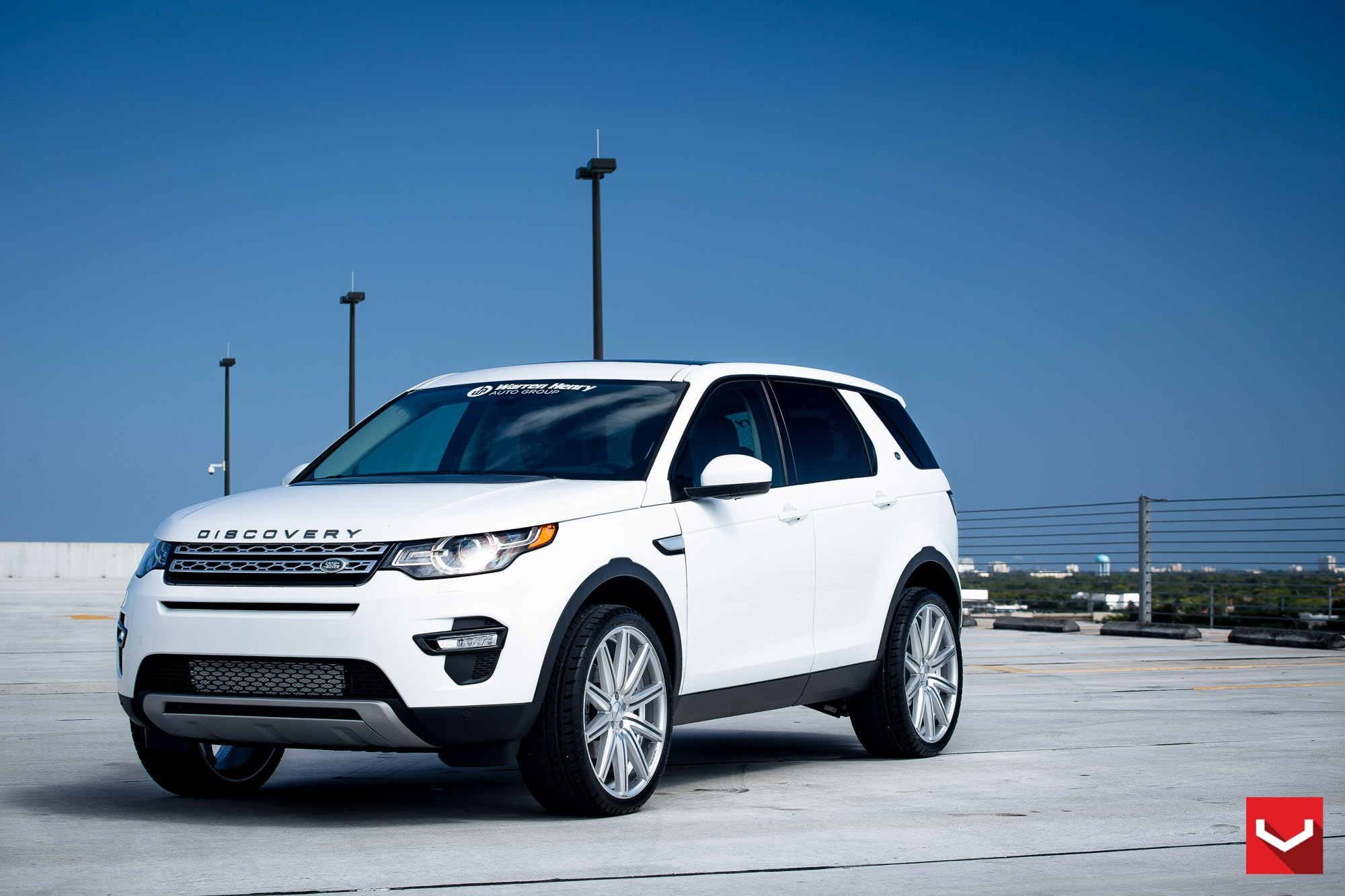 White Land Rover Discovery With Black Custom Accents