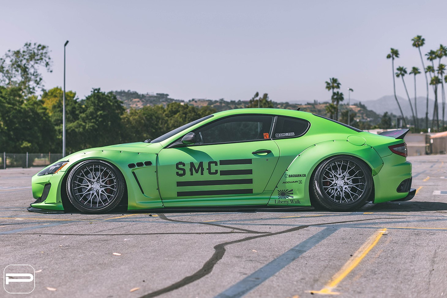 Green Maserati Granturismo with Aftermarket Fender Flares - Photo by PUR Wheels
