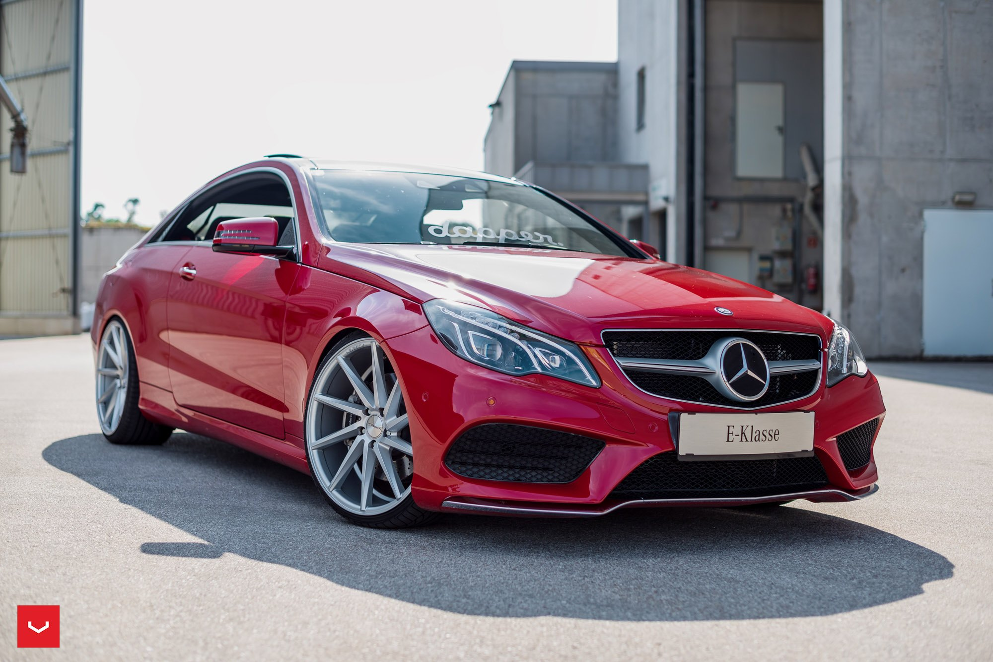Custom mercedes e class grabs attention due to red for Mercedes benz custom parts