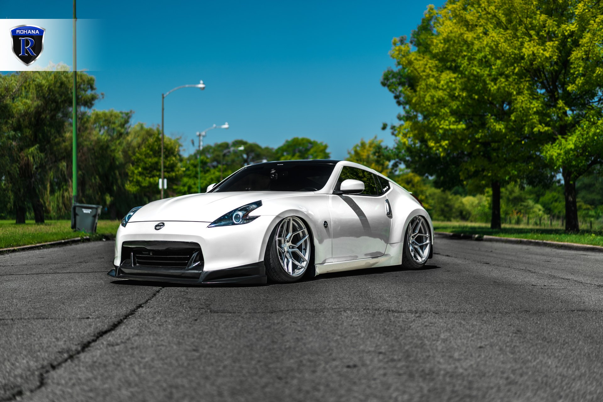 White Lowered Nissan 370Z with Custom Halo Headlights - Photo by Rohana Wheels