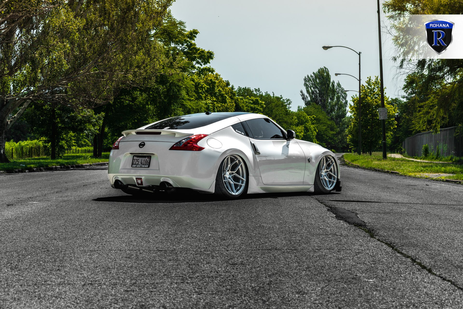 Aftermarket Rear Spoiler on White Nissan 370Z - Photo by Rohana Wheels