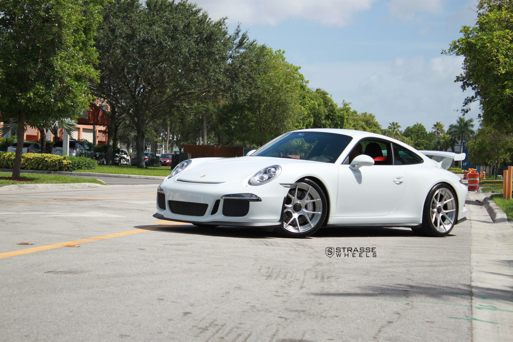 When White Porsche 911 Looks Bossy Sitting On Brushed