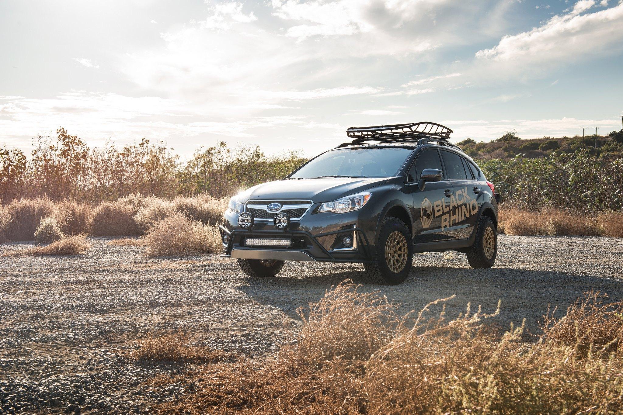 Black Subaru Crosstrek Rocking a Set of Matte Gold Black Rhino