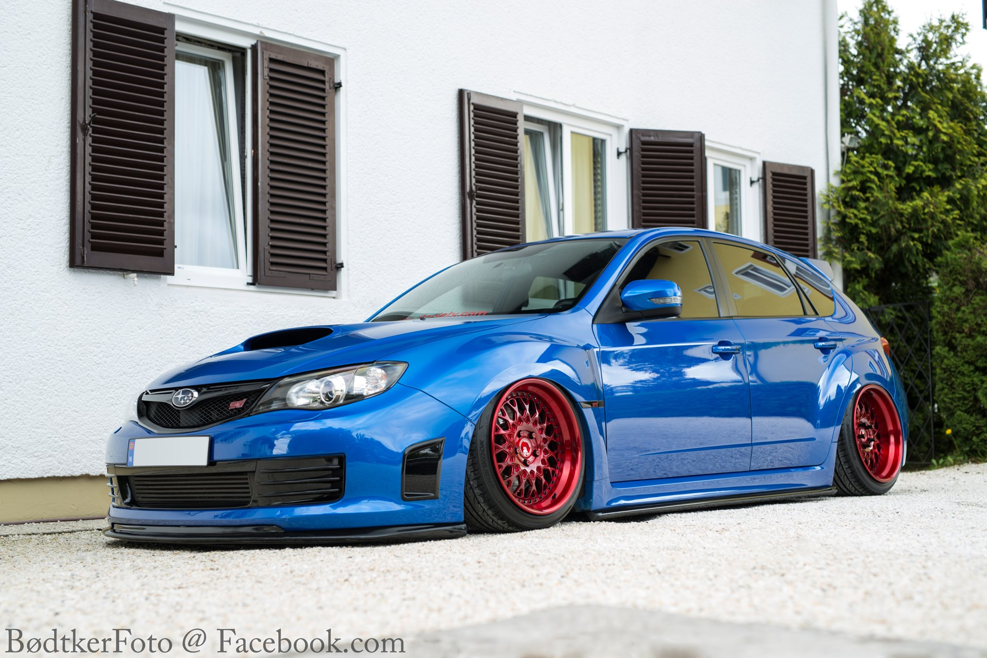 Aftermarket Hood on Blue Stanced Subaru WRX - Photo by Avant Garde Wheels