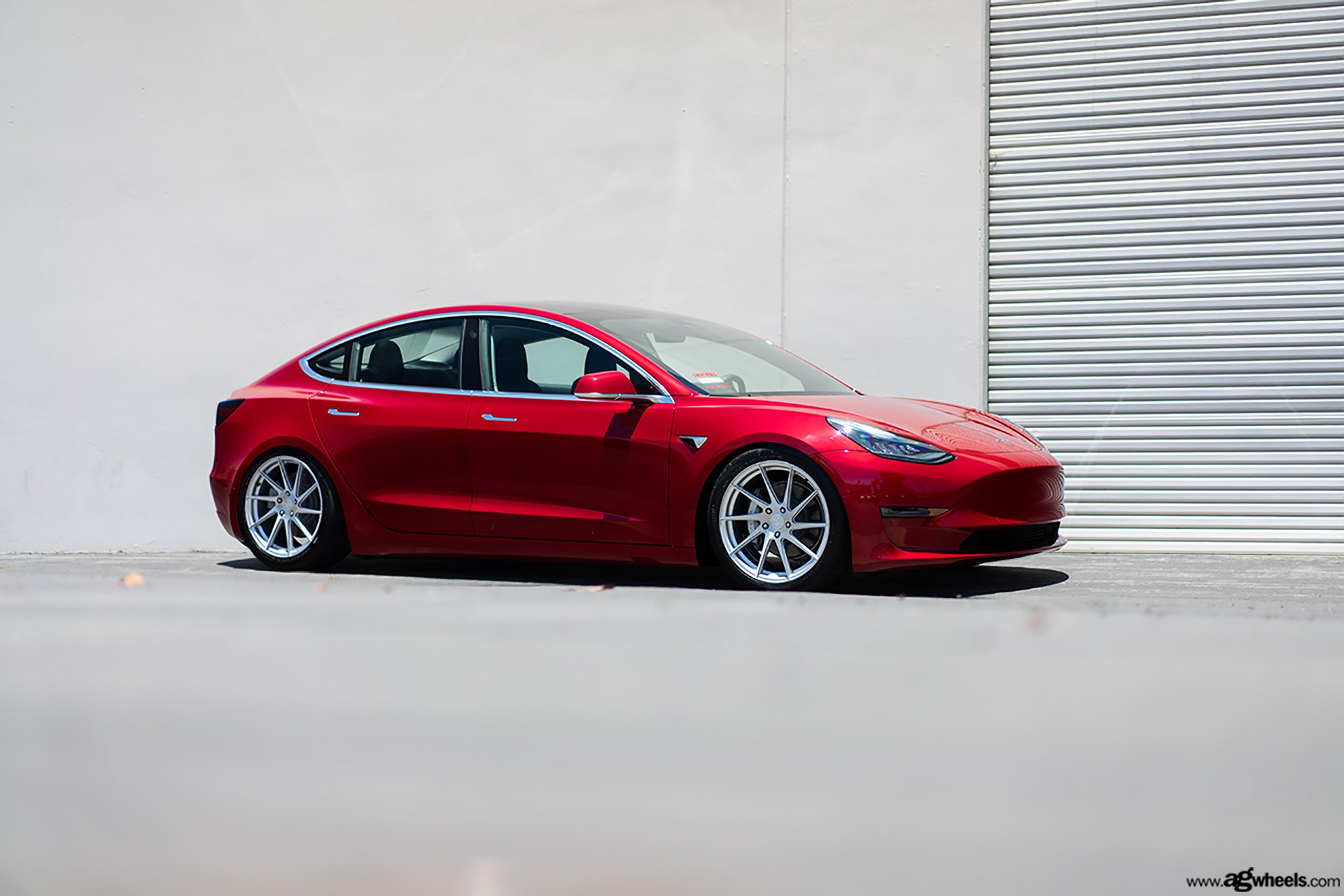 Where Technology and Style Merge: Red Tesla Model 3 Rocking