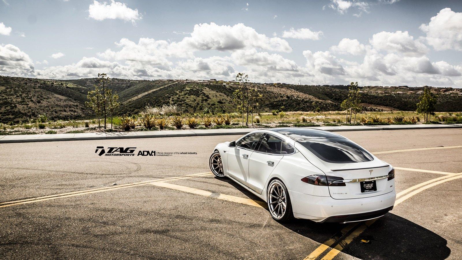 Car Enthusiast's Dream: White Tesla Model S on Custom Rims
