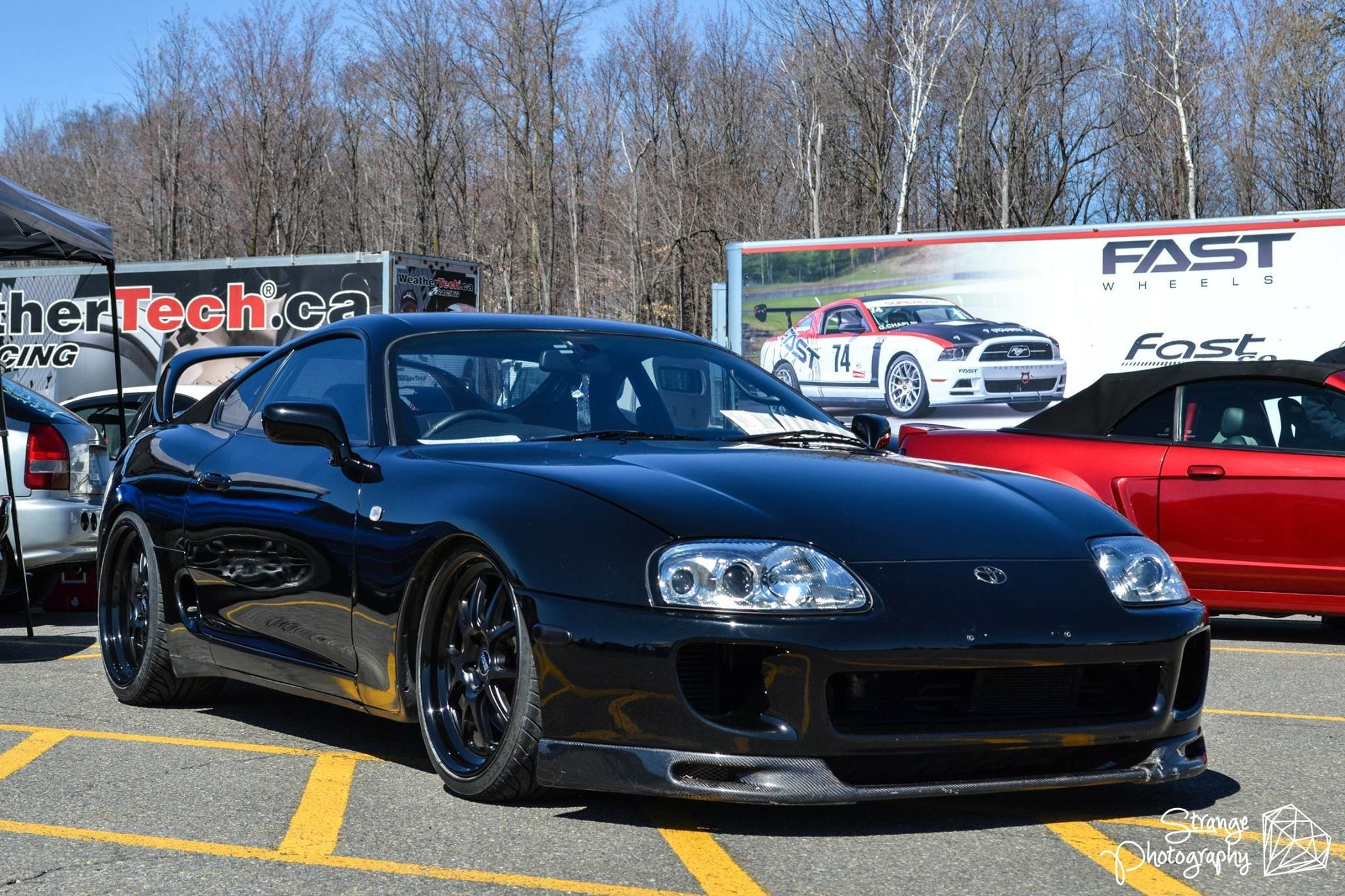 Modified black toyota supra for car enthusiasts appreciation carid carbon fiber front lip on black toyota supra photo by concept one voltagebd Choice Image