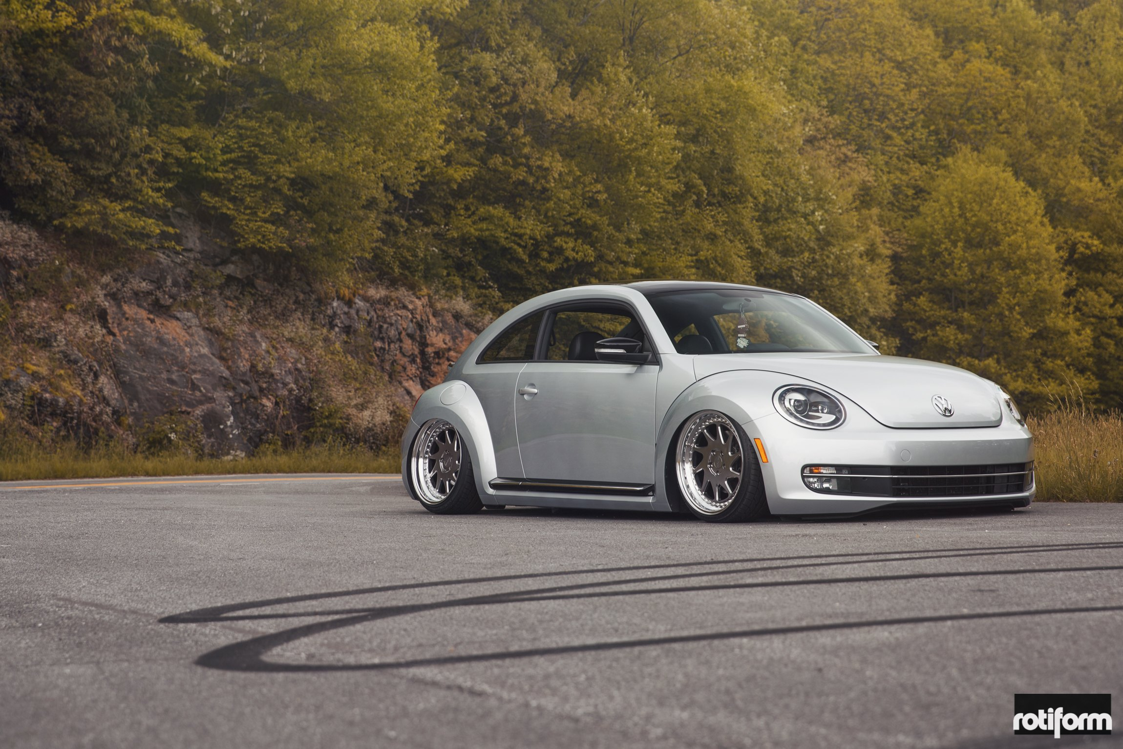 Silver Stanced VW Beetle with Aftermarket Front Bumper - Photo by Rotiform